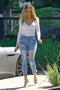 Khloe Kardashian wearing Yeezy Season 2 Lucite Heels, Good American Good Legs Fray Jeans in Blue018 and Naked Wardrobe Make It Clasp Bodysuit
