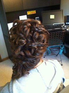 curls weaved to the side with braids