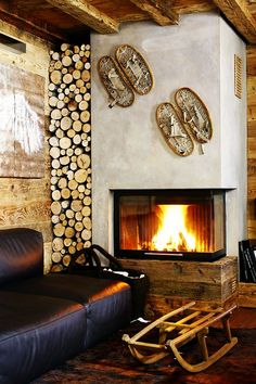 Fireplace n a rustic home in Cortina d'Ampezzo, Italy designed by Gianpaolo Zandegiacomo