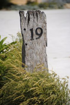 Beach House number using wood from an old pier