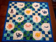 Baby quilt using 9 patch blocks and Embroidery Library Sea Life designs in the alternating blocks