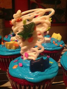 Sharknado cupcakes!! The tornado was made from melted chocolate and funfetti happy birthday aqua blue icing came with fish sprinkles. Throw on some shark gummies and you have a sharknado that's better than the movie!