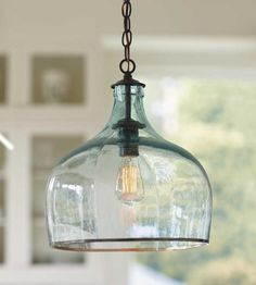 Charming and chic, our recycled glass pendant light adds an elegant touch of farmhouse flair and offers eco-friendly style. The lights are created from vintage, glass wine jugs, knows as balons, often found originally throughout central Europe. Artisans repurpose them by removing the bottom of the jugs, giving the lights their curvy half-globe shape. Each light, due to its recycled nature, is a unique piece of timeless style that you will admire in your home for years to come. Made in…
