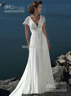 This is technically a maternity wedding dress, but I like the empire line and sleeves. Not sure the low cut would work, but pinning anyway :-)