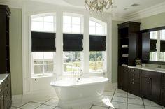 Bathrooms - JENNIFER PACCA INTERIORS  #interiordesign #homedecor #chandelier #hisandhers #design #decor #masterbathroom #soakingtub #vanity #romanshades #bathroomstorage #inspiration #interior #bathroom #woodvanity #beforeandafter #newbathroom #luxuryrealestate #bathroomremodel #bathroomdesign #realestate #remodeling