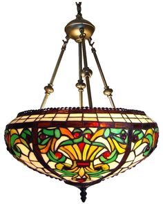 """Luxury in lighting is what this Victorian design reverse Tiffany style hanging lamp brings to your home. The design is done predominately in brown, green and white. The lamp has a diameter of 16 inches and needs a 27 inch clearance from the ceiling. It is hard wired for a wall switch and comes with a ceiling cap. All of our Tiffany style lamps are UL approved."""
