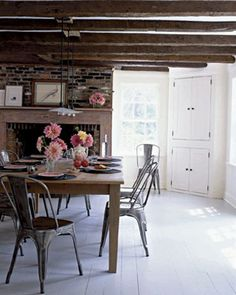 Euorpean Farm Style kitchen designed by Selina van der Geest. Great fireplace in dining area and exposed beams