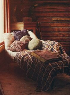 Rustic bedding ona comfy sofa for cuddling up