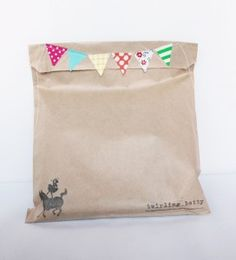 Sewn and stamped brown paper bags... brilliant