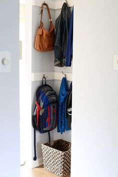 Even a small nook can provide a lot of storage with a few hooks.