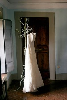 The Brides dress hangs ready before the wedding ceremony. Groomswear by Louis Copeland & Sons. Photography by: Ros from Couple Photography. Wedding Blog, Wedding Photos, Real Weddings, Destination Weddings, Wedding Couples, Couple Photography, Wedding Ceremony, Brides, Tuscany Italy