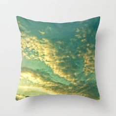 This pillow makes us feel like we are on our backs, watching the sun set.