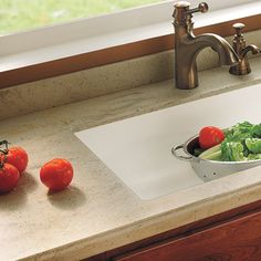 alternative to granite: Solid surface can be ordered with an integral sink, so there are no seams to clean. Its warm matte finish resists heat, and can be sanded if it gets scratched. The acrylic polymer material comes in dozens of colors, including ones that mimic the look of stone, such as Carrara marble and lapis lazuli. Shown: Buried Beach by Corian