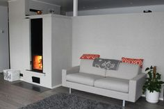 Both hearth and baking oven, a thermal mass heater, a tradition in Finland, more popular than ever in modern homes Thermal Mass, Sofa, Couch, Modern Homes, Hearth, Finland, Oven, Popular, Traditional
