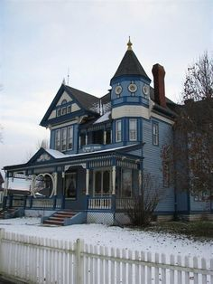 A fine house with a great body color, although the whole thing is a bit monochromatic.  Love the turret, the porch, the molding framing the porch, the screen doors, everything.  A right-out-of-the-country Victorian.