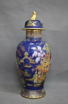 Good Carltonware Porcelain Ginger Jar and Cover,with domed kylin cover, above tapering meiping body, decorated with chinoiserie landscape, in tones of orange, yellow, green and gilt on cobalt ground,h 35cm
