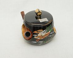 Rare Vintage French Emaux d'Art Pipe Tobacco Faience Jar Hand Painted Decor Duck Hunter Style Black and Gold, Signed Tess, Vallauris by FRBrocante on Etsy https://www.etsy.com/listing/174265400/rare-vintage-french-emaux-dart-pipe