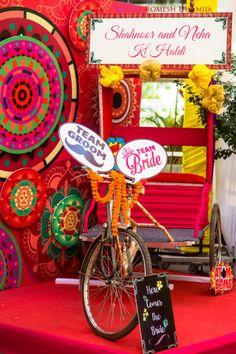 Great idea for the photo zone! Photo by Romesh Dhamija Productions, Mumbai , Great idea for the photo zone! Photo by Romesh Dhamija Productions, Mumbai , Desi Wedding Decor, Wedding Stage Decorations, Wedding Mandap, Backdrop Decorations, Wedding Ideas, Wedding Receptions, Mehendi Decor Ideas, Mehndi Decor, Mehndi Ceremony
