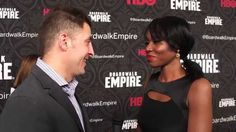 "Amanda Warren who plays Lucy Warburton on HBO's ""The Leftovers"" chats with Arthur Kade on the red carpet of the final season of ""Boardwalk Empire""."