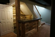 Under stairs closet turned into a bar. Concrete countertop, barn wood, pallets.