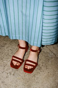 Suzanne Rae's puffy strap platform sandal in red velvet is the perfect statement shoe. Style with everything, from an ultra feminine dress to men's inspired workwear pants.