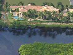Jupiter waterfront estate for sale. 19160 SE Reach Island Lane in gated Islands of Jupiter. 365 ft. riverfront. $4,000,000.