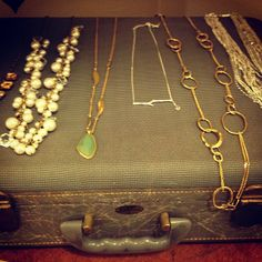 Recovering the top of an old suitcase gives another place to display jewelry..stored inside the case for portability.