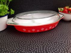 1950's Pyrex  Red Gaiety Snowflake Divided Dish In Good Condition with lid  by Onmykitchentable on Etsy https://www.etsy.com/listing/226184481/1950s-pyrex-red-gaiety-snowflake-divided