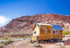 A wooden tiny house on wheels with wood siding and a gabled roof. Click through for more photos of this adorable home.