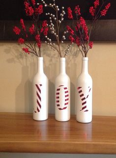 Use bottles, soda bottles, beer bottles, or wine bottles. Cover a part of a bottle in red paper. Spray paint everything else white and cover the red with stripes of white, and turn it into letters.