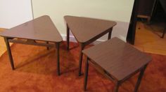Awesome set of mid century modern side tables at a great price! Laminate tops with walnut (?) bases. Very cool, modern shapes. There is no makers