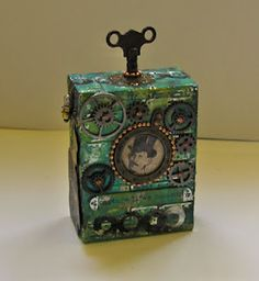 artsaveslives-chunky atc  I like the Oz-like feel of this.  Emerald and clockwork.  Like it belongs in the Gnome King's collection.