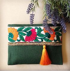 Green Floral Clutch, Bohemian Clutch, Boho Bag, Fashion Bag, Womens handbag, gift for her, Clutch purse, Ethnic Clutch, Handmade gift A fashion statement that will catch everyones attention! This floral clutch will bring elegance to your style. It will be chic with jeans or dresses and you may use this clutch bag both day and night. This clutch bag is perfectly handmade with high quality grey jute fabric. Designed with a silk bohemian embroidery and a tassel. Clutch has a mustard yellow…