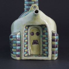 A Rare 19th Century Famille Jaune Biscuit Porcelain Ewer in the Form of a Brick Built Jingdezhen Egg-Shaped Kiln. The Side of the Kiln is Decorated with Butterflies.  It appears this rare model of a kiln was in fact a ewer even though there is no lid. One of the examples sold at Christie`s had a removable and the few know examples have two loops of porcelain where the handle would have been attached. Presumably these novelty ewers were sold to tourists at Jingdezhen.