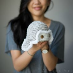 """I love being able to gift handmade crocheted items, particularly to babies! Their cute little items ranging from baby booties to hats can be something that their parents treasure forever, and of course they make great photo shoot items for newborns! We recently met a new baby boy, and I wanted to crochet him a little hat with yarn that I already had on hand. I found this adorable free pattern on Ravelry HERE for """"Little Lindy's Aviator Hat""""! I love how it's a different spin on the tr..."""