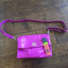Authentic Tory burch cross body Pink Tory burch cross body. Good condition. Light wear and tear on the bottom corners. Tory Burch Bags Crossbody Bags
