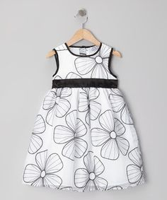 Equal parts sweet and stylish, this fabulous frock boasts a beautiful floral-embroidered overlay and contrasting trimming. A button-up back and tie-waist paired with a roomy skirt makes dressing easy and wearing comfy.