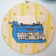 """Happieness Ever After""  machine embroidery, acrylic paint, vintage buttons on vintage fabric framed in 12"" hoop"