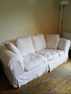 White sofa bed, used but in good condition. All covers are removable and washable. Viewing available