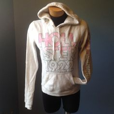 Hollister hoodie. Off white, pink and grey. Pre loved but in good condition. Very cute. Hollister Tops Sweatshirts & Hoodies