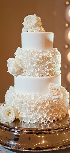 Who says the ruffles have to stay on the dress? For a cake as flamboyant as the bride, it's got to be ruffles.