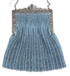Rainbow blue on blue/gray beaded knitted purse held on antique filigree purse frame.