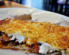 """The Hangover""  Hash browns stuffed with bacon, sour cream, cheese & a side of biscuits & gravy"