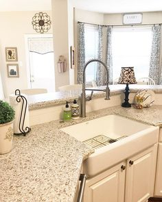 100 Inspiring Farmhouse Sink Ideas for the Kitchen and Bathroom - You have to see this #farmhousesink decor idea with double-soap container set and a modern nightstand lamp. Love it! #FarmhouseSinkDecor #HomeDecorIdeas