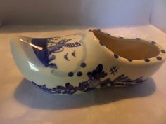 A large pottery blue and white clog. Made in Holland to a traditional design, this is 7 long and over 3 wide. It has a picture of a windmill on the apron and flowers an leaves on the sides. White Swan, Blue And White, Flower Spray, Traditional Design, Dutch, Clogs, Vintage Items, Pottery, Etsy Shop