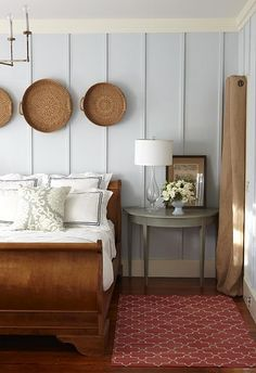 Bedroom inspiration, sleigh bed with chunky legs, blue wall, MDF panelling, baskets, geometric rug, crown molding, #bedroom