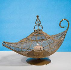 The Magic Lamp Centerpiece is a great centerpiece for your next theme party. The Magic Lamp Centerpiece is 12 l and 8 h and will make a great table decoration for your Arabian theme.