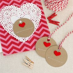 Super sweet and simple handmade gift tags using kraft paper, felt and stitching! Great for Valentine's Day!