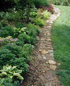 BelleWood-Gardens - Diary Love this rustic, casual edging. This would work nicely on the slope in the back to help with the washing.: