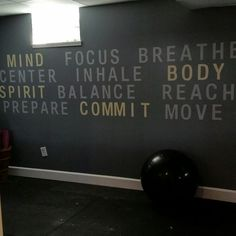 """I painted free hand 12"""" letters in our Home Gym/Yoga Studio """"MIND, BODY and SPIRIT.. COMMIT"""" highlighted in yellow (ignore the crooked plug cover and floor mess. I was working on some other things)"""